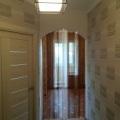 Бирюзовые шторы в гостиной